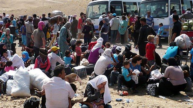 130905_xk0mg_rci-refugees-many_sn635