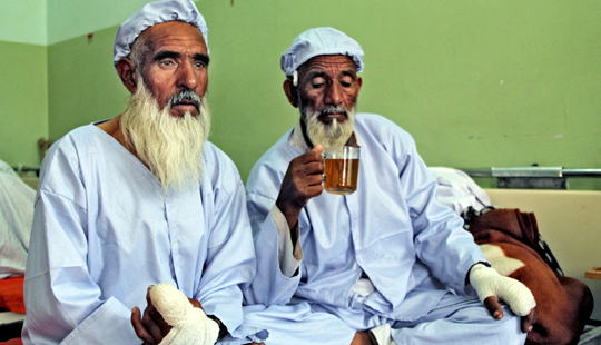 Afghan men, who had their fingers cut off by Taliban fighters as a punishment for voting
