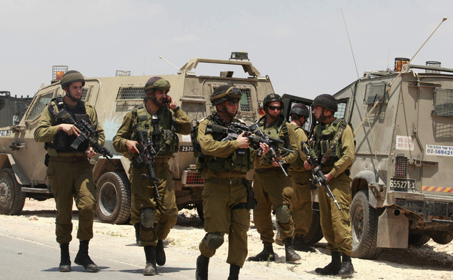 Israeli soldiers deploy near the West Bank city of Hebron on Friday.