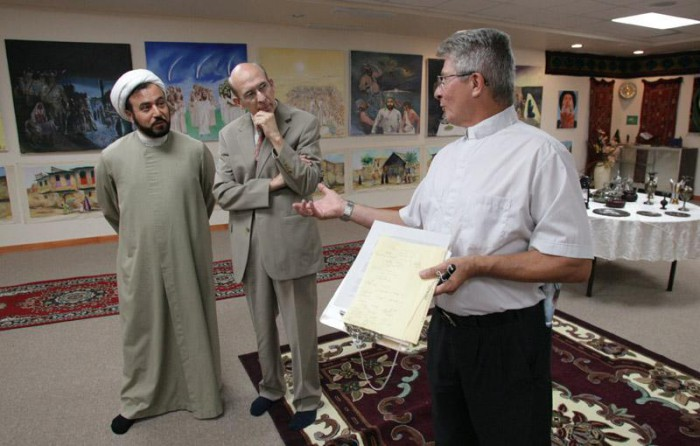 Sheikh Husham Al-Husainy, left, meets with interfaith leaders at the Karbalaa Islamic Educational Center