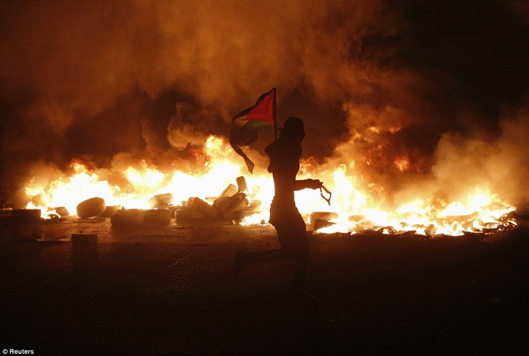 1406274074023_Image_galleryImage_A_Palestinian_protester_h