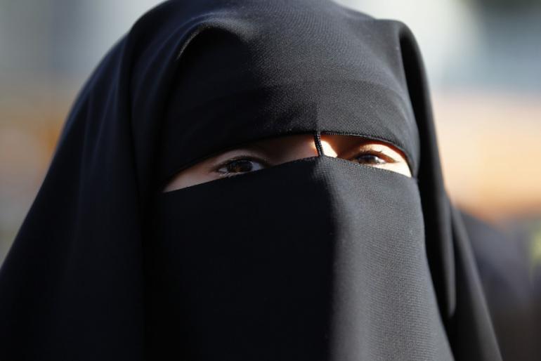 204837-hind-ahmas-wears-a-niqab-despite-a-nationwide-ban-on-the-islamic-face-