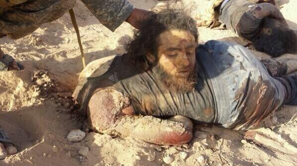 man-beheaded-isil-in-al-shehail-5-25-2014