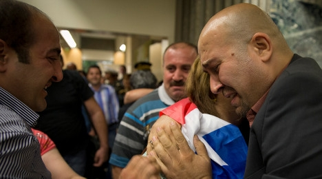 Iraqi Christians sob for joy at being allowed asylum in France