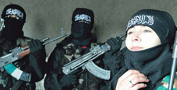 Sabina, pictured beside jihadists wielding Kalashnikov rifles, somewhere