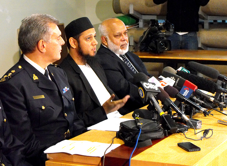Mufti Aasim Rashid, spokesperson for the B.C. Muslim Association speaks at a Friday press conference attended by international media at the Burnaby mosque on Canada Way. He is flanked by Wayne Rideout, assistant commissioner of the RCMP, and Musa Ismail, president of the B.C. Muslim Association