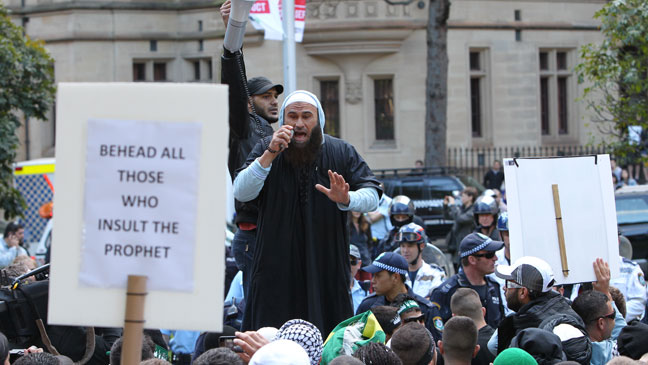 Muslims hold up signs like this in Australia