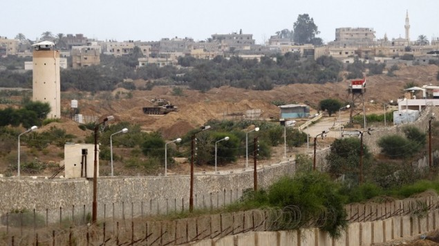 Egyptian army soldiers seen in a watchtower on the Rafah border with the Gaza Strip