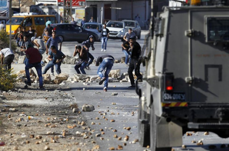 Paliscum from the Jalazoun refugee camp clash with Israeli security forces at the entrance of the Jewish West Bank neighborhood of Beit El, north of Ramallah, after a march against Israeli restrictions on the Al-Aqsa mosque