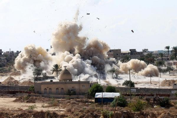 An image of Egyptian military demolishing homes in Northern Sinai on Wednesday to create buffer zone along the borders with Gaza