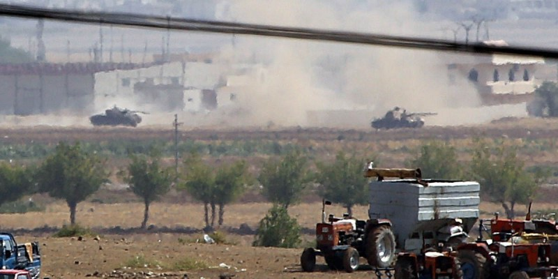 Tanks belonging to ISIS firing on Ayn al-Arab city (Kobani) during clashes with Kurdish armed groups