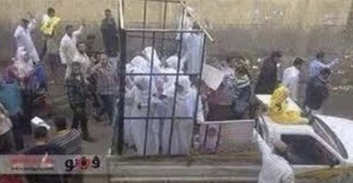 Caged women being sold off as sex slaves in Mosul, Iraq