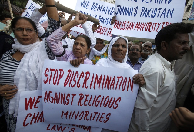 Protesters hold up placards while demanding the release of Asia Bibi, a Pakistani Christian sentenced to death for blasphemy in Karachi