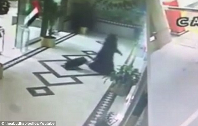 In other newly-released footage, the suspect is seen dragging a small suitcase towards where an Egyptian-American doctor lives. She is accused of leaving a home-made bomb outside his door