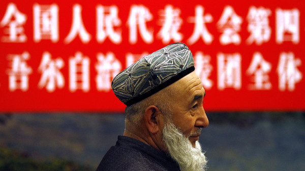 A delegate from the Xinjiang provincial delegation is seen before the start of their meeting with representatives from the National People's Congress in Beijing