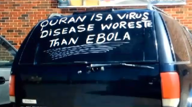 Sign painted on the back of the Somali Christian's car