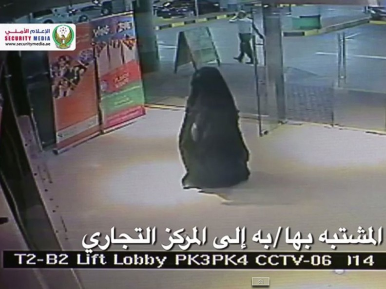 A person, dressed in a black burqa suspected in the killing of a U.S. woman enters shopping mall at Al Reem Island in Abu Dhabi