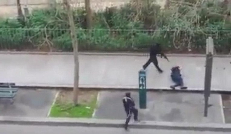Brutal execution: A police officer pleads for mercy on the pavement in Paris before being shot in the head by masked gunmen during an attack on the headquarters of the French satirical publication Charlie Hebdo