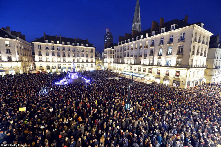 People gather at the Place Royale in Nantes to show their solidarity for the victims of the attack on the offices of the satirical weekly
