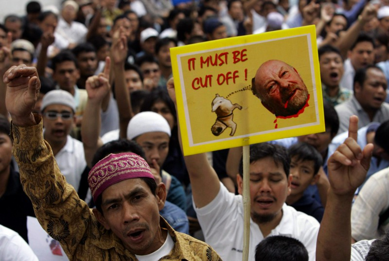 Muslims around the world threaten to cut off the head of Kurt Westergaard, the cartoonist behind a picture of Mohammed with an exploding bomb on his head