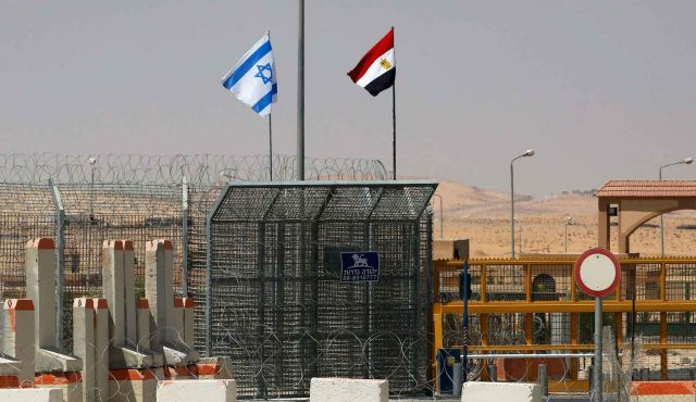 Israeli and Egyptian flags fly side by side