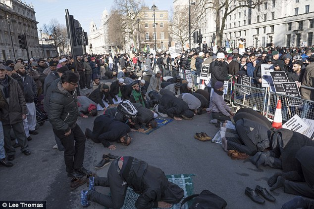 UK Muslims lifting their asses to Allah in the middle of the street