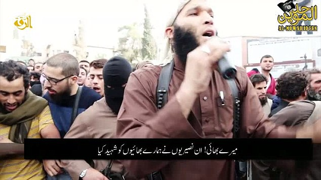 The video begins by a bearded cleric breathlessly reading out charges against three Syrian soldiers