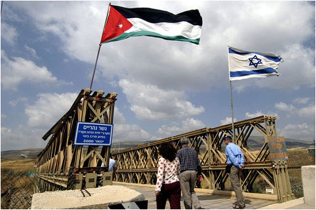 Jordanian and Israeli flags fly side by side