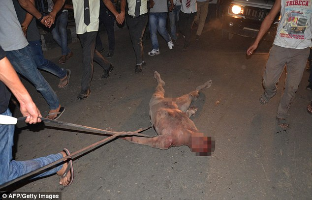 Naked and beaten to death, then lynched