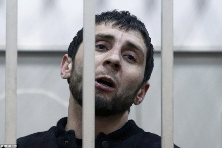 Dadayev, 33, was forced to speak from inside a defendants' cage during the hearing at the district court