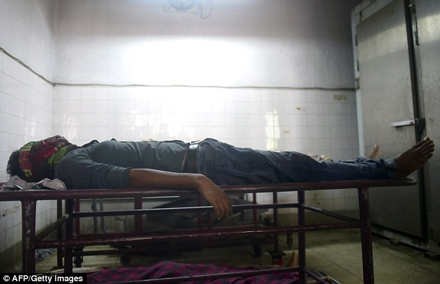 The body of Bangladeshi blogger Washiqur Rahman lies in a morgue at Dhaka Medical College in Dhaka after he was hacked to death