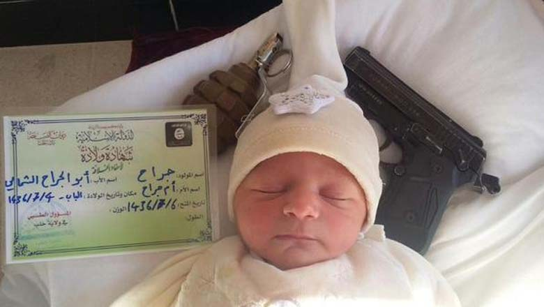 First official ISIS newborn with ISIS birth certificate and appropriate gifts