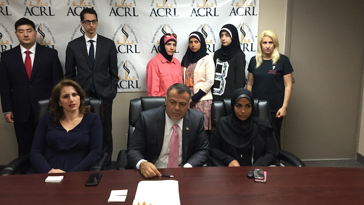 Dakroub (right) sitting in front of her family at the ACRL office on Thursday, May 28.