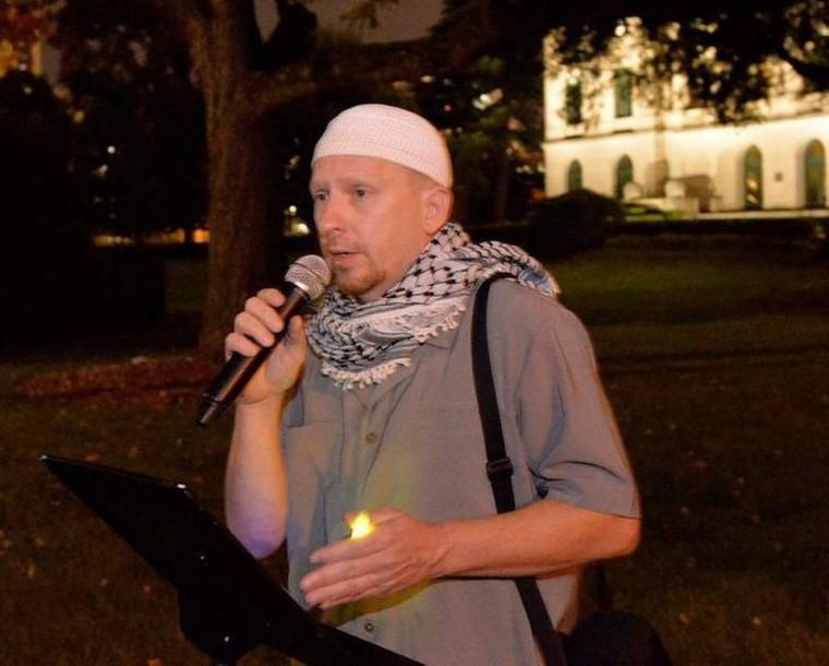 Jibril Hough favors wearing Palestinian/Hamas scarves