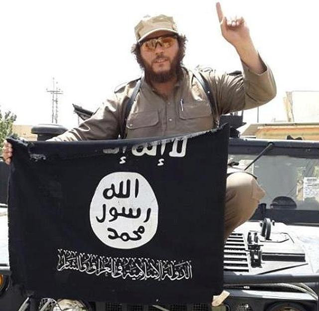 Australian Khaled Sharrouf with ISIS flag