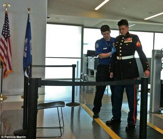 Wounded U.S. Marine and Iraq veteran was treated 'shamefully' because he couldn't raise his injured arm and was ordered to take off dress uniform because it had 'too much metal.'