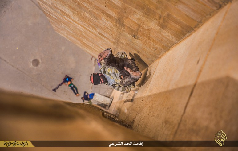 isis-executes-three-homosexuals-by-throwing-them-off-roof-graphic-pictures-14113