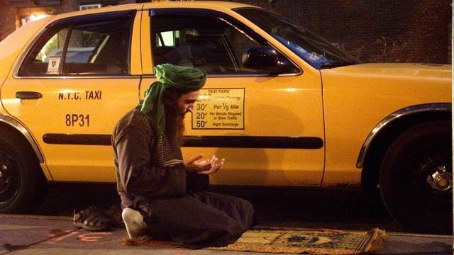 Paki Muslim Taxi driver Aadil Toppa stops to pray in the middle of his shift in New York City.