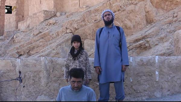 isis-child-beheading-captive-graphic-photos-21120