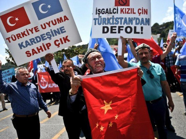 Muslims protest in front of the Thailand embassy in Turkey against the kingdom's deportation of Uighur Muslims to China