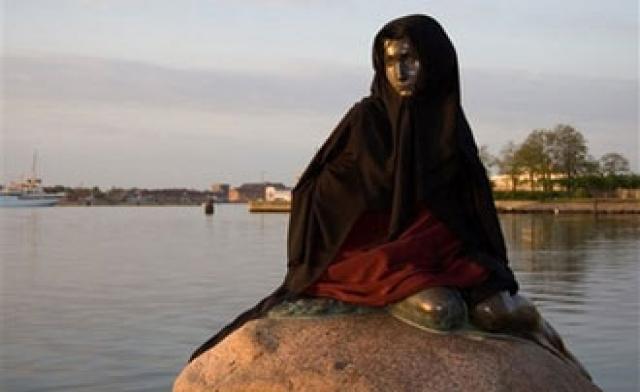 Famous symbol of Denmark wearing a Muslim headbag