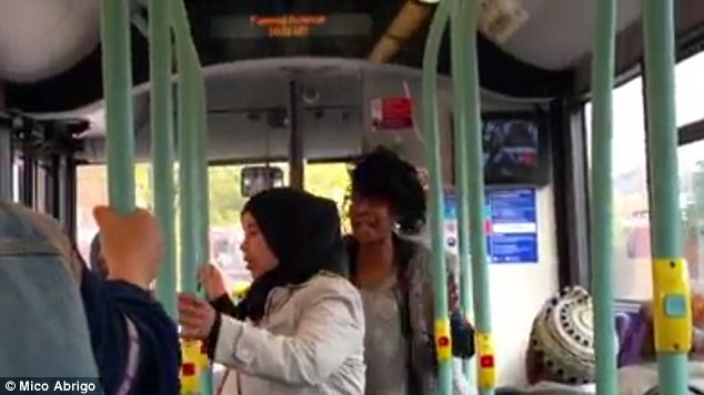 2D7780E800000578-3275447-One_of_the_Muslim_women_can_be_heard_asking_her_to_finish_and_st-a-9_1444988783669-1