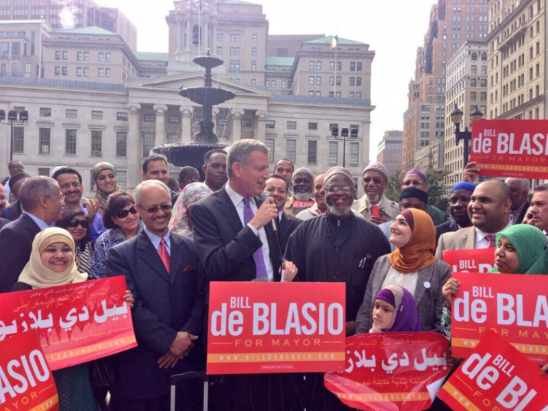 Sarsour (in rust-colored Muslim headbag) is smitten with deBlasio, who cracked down and ended the NYPD's surveillance of Muslims