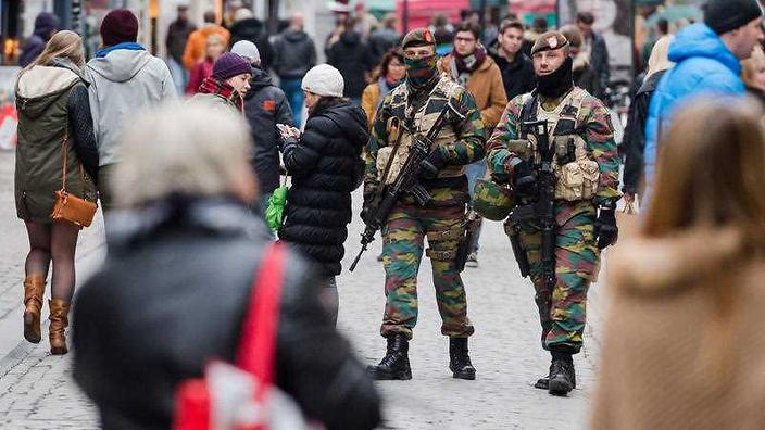 Soldiers from the Belgian army patrol in the Grand Place in Brussels
