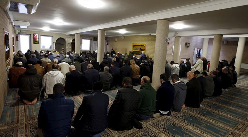 Members of the Muslim community attend the Friday prayer at Attadamoun Mosque in the neighbourhood of Molenbeek, in Brussels, Belgium,