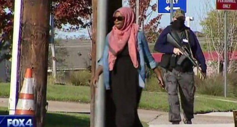 Muslim baghead being watched by armed anti-Islam patriot in Texas