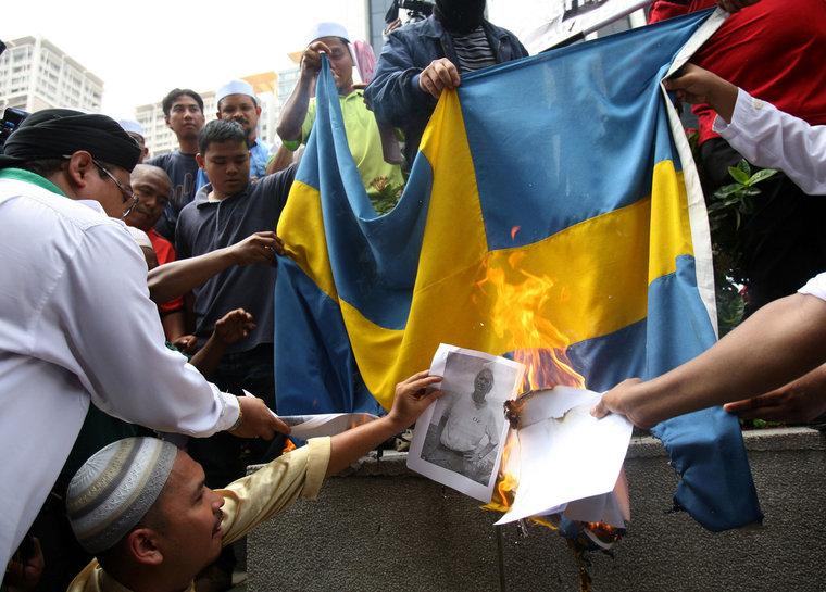 Muslim burning Swedish flag