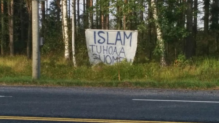 """Banner says """"Islam is destroying Finland"""""""