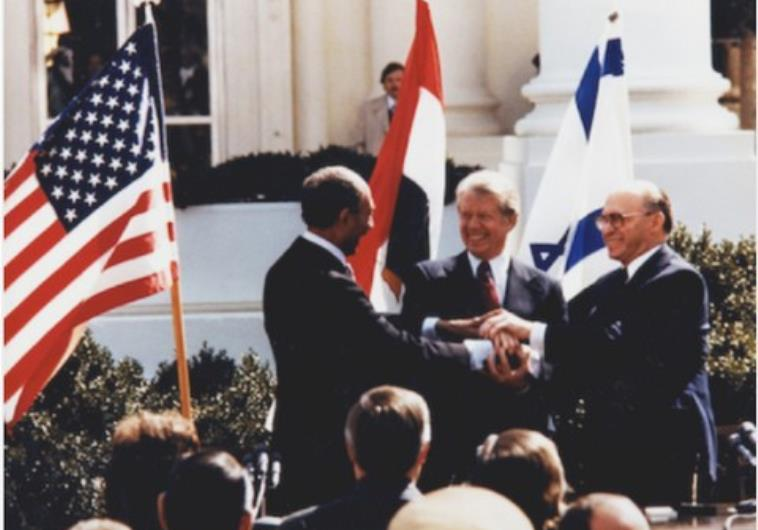Egyptian President Sadat -Israeli prime minister Menachem Begin with President Jimmy Carter at the signing of the peace accord