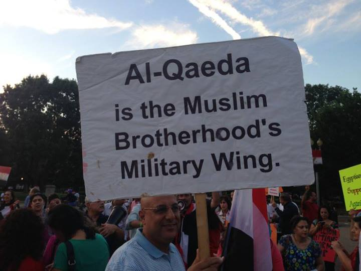 Posters held up by Egyptian Americans